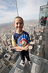 A boy out on the Ledge at the Willis Tower Skydeck, Chicago, IL