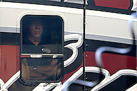 May 11, 2013; Commerce, GA, USA: NHRA team owner Alan Johnson watches out of the window of their car hauler of top fuel dragster driver Shawn Langdon during the Southern Nationals at Atlanta Dragway. Mandatory Credit: Mark J. Rebilas-