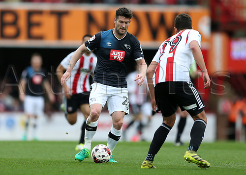 April 14th 2017,  Brent, London, England; Skybet Championship football, Brentford versus Derby County; David Nugent of Derby County brings the ball forward with Yoann Barbet of Brentford marking the Derby County forward
