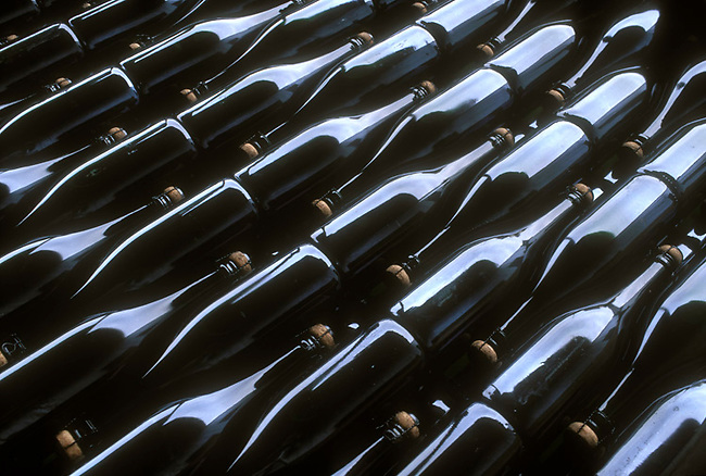 Bottles of sparkling wine ready for labeling at Argyle Winery, Oregon