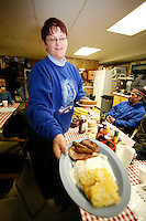 Thursday March 8, 2007   ----  Spyder Pollreis serves a hearty breakfast to mushers at Takotna on Thursday morning.  Takotna is known as one of the friendliest villages along the trail and the best food.