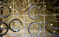 Canning lids wait to be washed and disinfected as part of the important first step in the canning process at the home of Wall Street Journal Reporter Ana Campoy (cq) in Dallas, Texas, USA, Saturday, Sept. 12, 2009. Growing produce or buying locally grown vegetables and canning at home is a fun and healthy way to keep grocery costs down...CREDIT: Matt Nager for The Wall Street Journal