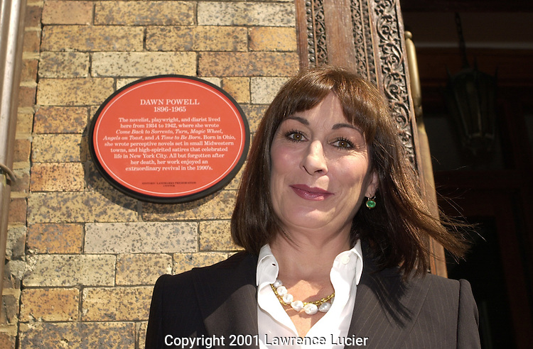 """Anjelica Huston dedicates a cultural medallion at 9 East 10th St in NYC. The medallion, a program of  Historic Landmarks Preservation Center,  memorializes author Dawn Powell, a house resident from 1934 to 1942. Huston is writing a screenplay from Powell's """"A Time to Be Born."""""""