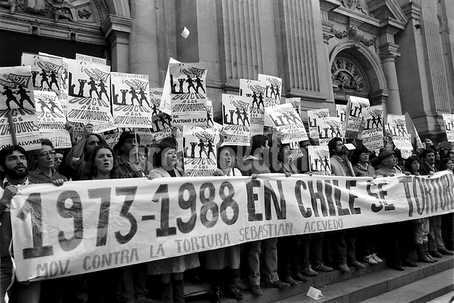 Miembros del Movimiento Contra la Tortura Sebastian Acevedo denuncian la tortura al cumplirse 15 a&radic;&plusmn;os de Pinochet en el poder.<br /> Santiago Chile 14 septiembre 1988<br /> <br /> Forty years ago, on September 11, 1973, a military coup led by General Augusto Pinochet toppled the democratic socialist government of Chile. President Salvador Allende was killed during the  attack to seize  La Moneda presidential palace.  In the aftermath of the coup, a quarter of a million people were detained for their political beliefs, 3000 were killed or disappeared and many thousands were tortured.<br /> Some years later in 1981, while Pinochet ruled Chile with iron fist, a young photographer called Juan Carlos Caceres started to freelance in the streets of Santiago and the poblaciones or poor outskirts, showing the growing resistance against the dictatorship. For the next 10 years Caceres photographed every single protest and social movement fighting for the restoration of democracy. He knew that his camera was his only weapon, he knew that his fate was to register the daily violence and leave his images for the History.<br /> In this days Caceres is working to rescue and organize his collection of images in the project Imagenes de la Resistencia   . With support of some Chilean official institutions, thousands of negatives are digitalized and organized to set up the more complete visual heritage of this  violent period of Chile&acute;s history.