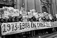 Miembros del Movimiento Contra la Tortura Sebastian Acevedo denuncian la tortura al cumplirse 15 a√±os de Pinochet en el poder.<br /> Santiago Chile 14 septiembre 1988<br /> <br /> Forty years ago, on September 11, 1973, a military coup led by General Augusto Pinochet toppled the democratic socialist government of Chile. President Salvador Allende was killed during the  attack to seize  La Moneda presidential palace.  In the aftermath of the coup, a quarter of a million people were detained for their political beliefs, 3000 were killed or disappeared and many thousands were tortured.<br /> Some years later in 1981, while Pinochet ruled Chile with iron fist, a young photographer called Juan Carlos Caceres started to freelance in the streets of Santiago and the poblaciones or poor outskirts, showing the growing resistance against the dictatorship. For the next 10 years Caceres photographed every single protest and social movement fighting for the restoration of democracy. He knew that his camera was his only weapon, he knew that his fate was to register the daily violence and leave his images for the History.<br /> In this days Caceres is working to rescue and organize his collection of images in the project Imagenes de la Resistencia   . With support of some Chilean official institutions, thousands of negatives are digitalized and organized to set up the more complete visual heritage of this  violent period of Chile´s history.