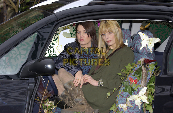 SADIE FROST & JEMIMA FRENCH.Revealing Their Designs for New Innovation Peugeot 1007..St Mary Magdelaine Church, Rowington Close, W2..February 16th, 2005.half length green jacket coat tight stockings boots car sitting butterflies.www.capitalpictures.com.sales@capitalpictures.com.©Capital Pictures