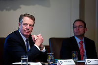 Robert Lighthizer, U.S. trade representative, listens beside Mick Mulvaney, acting White House chief of staff, as U.S. President Donald Trump speaks during a cabinet meeting in the Cabinet Room of the White House, on Wednesday, Jan. 2, 2019 in Washington, D.C. Photo Credit: Al Drago/CNP/AdMedia