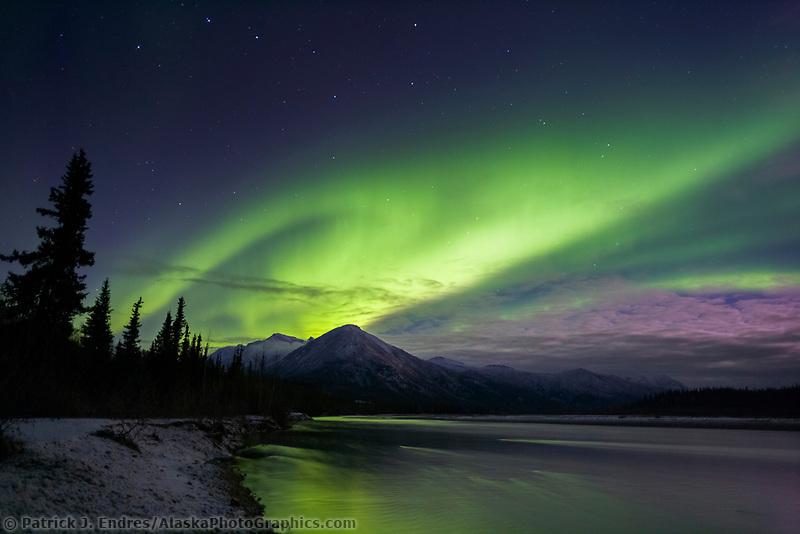 Aurora borealis over Midnight Dome mountain, Brooks range, Alaska.