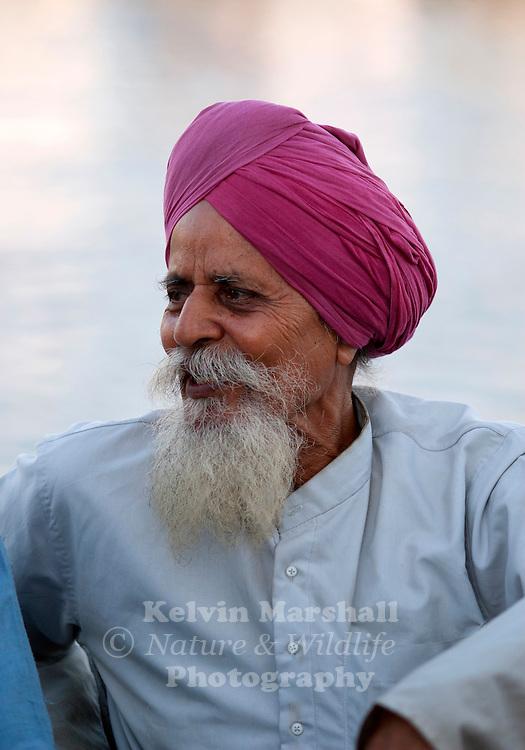 "Elderly Punjabi Sikh man relaxing at the Taj hotel. ""The Gateway to India"", Mumbai (Bombay) - India."