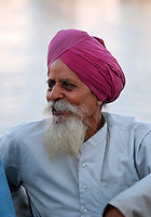 "Elderly Punjabi Sikh man relaxing at the Taj hotel. ""The Gateway to India"", Mumbai (Bombay) - India."