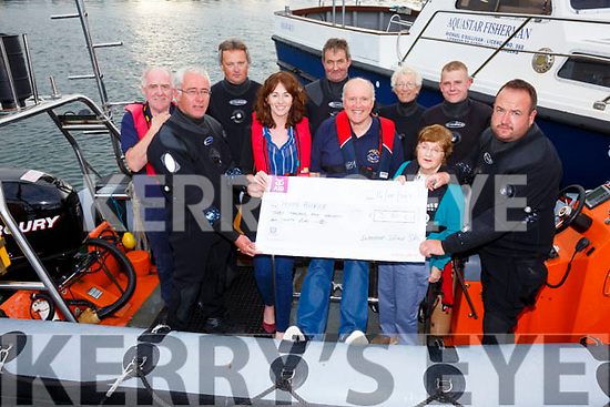 A cheque for €3,130 proceeds from the Inbhear Sceine SAC Dawn Dive at the Skelligs was presented to the Kerry Hospice on Monday evening pictured here front l-r; Gearóid Moran, Trish O'Sullivan(Iveragh Group Kerry Hospice), Nigel Kelliher, Mairead Lynch(Iveragh Group Kerry Hospice), Sean Moran, back l-r; Steve Lynott(Ballinskelligs Inshore Rescue), John Coyle, Johnny Coffey, Sue Weatherill & Stephen O'Sullivan.