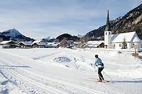 Germany, Bavaria, Upper Bavaria, Werdenfelser Land: village Graswang and Ammergauer Alps - woman cross country skiing | DEU, Deutschland, Bayern, Oberbayern, Werdenfelser Land: Graswang mit Ammergauer Alpen - Frau beim Skilanglauf
