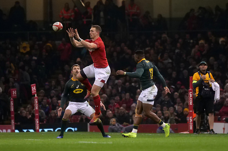 Wales' George North palms away the high ball <br /> <br /> Photographer Ian Cook/CameraSport<br /> <br /> Under Armour Series Autumn Internationals - Wales v South Africa - Saturday 24th November 2018 - Principality Stadium - Cardiff<br /> <br /> World Copyright © 2018 CameraSport. All rights reserved. 43 Linden Ave. Countesthorpe. Leicester. England. LE8 5PG - Tel: +44 (0) 116 277 4147 - admin@camerasport.com - www.camerasport.com