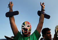A Mexico supporter reacts during a live broadcast of the soccer World Cup match between Brazil and Mexico<br />  on Copacabana beach, Rio de Janeiro, Brazil, June 17, 2014
