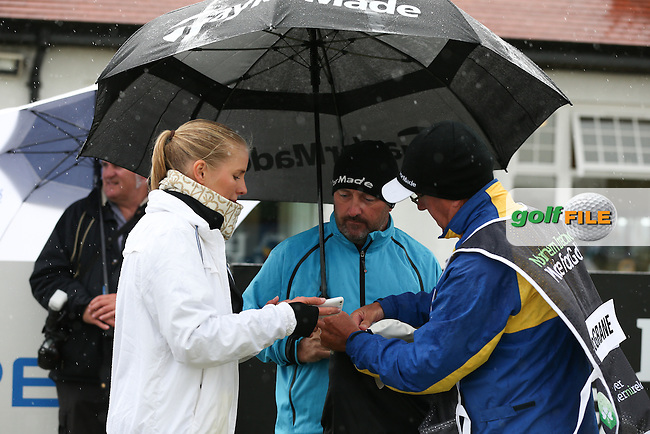 Damien McGrane (IRL) gets an explanation of how to use the GameBook app from Susanna Sarkki during the Pro-Am ahead of the 2015 Dubai Duty Free Irish Open Hosted by The Rory Foundation at Royal County Down Golf Club, Newcastle, Northern Ireland. 27/05/2015Picture David Lloyd | www.golffile.ie