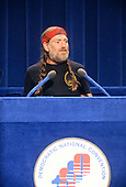 American musician, singer, songwriter, author, poet, actor, and activist Willie Nelson makes remarks at the 1980 Democratic National Convention in Madison Square Garden in New York, New York on August 13, 1980.<br /> Credit: Arnie Sachs / CNP