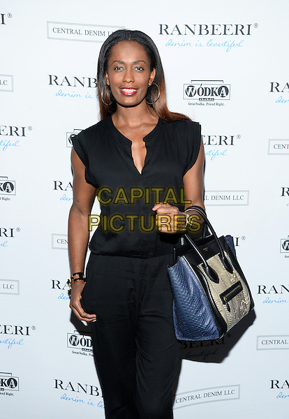 NEW YORK, NY - AUGUST  4: Swintayla Marie &quot;Swin&quot; Cash pictured at THE RANBEERI  DENIM  LAUNCH PARTY  at The James Hotel Hotel/Jimmy Rooftop in New York City  on August 4, 2015 in New York City<br /> CAP/MPI/PLURTN<br /> &copy;RTNPLU/MediaPunch/Capital Pictures