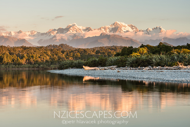 Sunset over Southern Alps with reflections in Gillespies Lagoon, Westland Tai Poutini National Park, West Coast, South Westland, UNESCO World Heritage Area, New Zealand, NZ