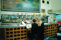 The bartender and waiter chat with a customer at La Faena,  one of the Cantinas from the old center of Mexico City. 5-14-04