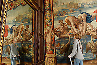 BNPS.co.uk (01202 558833)<br /> Pic: ZacharyCulpin/BNPS<br /> <br /> Renaissancespring clean<br /> <br /> A final inspection on the 'The Miraculous Draft of Fishes' Tapestry reflected in one of the ornate mirros at Forde Abbey<br /> <br /> The annual spring clean of the Mortlake Tapestriesat Forde Abbey in Dorset.<br /> <br /> They took over 3 weeks to clean, a scaffolding platform was used to reach the top of the 18 foot historic works of art.<br /> <br /> The tapestries are hung on the walls in the saloon of Forde Abbey, They are woven from the cartoons painted by Renaissance master Raphael, they depict the scenes from the lives of St Peter and St Paul, as described in St John's Gospel and Acts of the Aspostles. <br /> <br /> The original tapestries were commissioned for the Sistine Chapel, in Rome, by Pope Julius II, and were first woven in Brussels in about 1520. This set was made in London at the Mortlake factory about hundred years later.<br /> <br /> Raphael's cartoons depicted in the tapestries include: The Miraculous Draft of Fishes, Panel from 'The Death of Ananias,' The Healing of the Lame Man, Christ's charge of St Peter and The Sacrifice at Lystra before St Paul and St. Barnabus.<br /> <br /> Forde Abbey is a former Cistercian monastery in West Dorset dating back to the early 12th century.