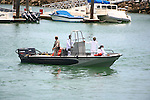 Mexican military representatives in small watercraft. <br />