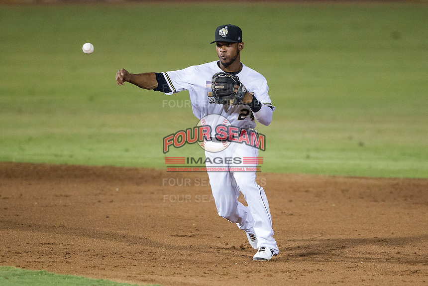 San Antonio Missions shortstop Jeudy Valdez (24) makes a throw to first base in the Texas League baseball game against the Frisco Roughriders on August 22, 2013 at the Nelson Wolff Stadium in San Antonio, Texas. Frisco defeated San Antonio 2-1. (Andrew Woolley/Four Seam Images)