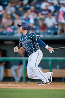 Jacksonville Jumbo Shrimp left fielder Austin Dean (9) follows through on a swing during a game against the Mobile BayBears on April 14, 2018 at Baseball Grounds of Jacksonville in Jacksonville, Florida.  Mobile defeated Jacksonville 13-3.  (Mike Janes/Four Seam Images)