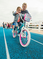 NWA Democrat-Gazette/BEN GOFF @NWABENGOFF<br /> Harper Magnuson, 6, of Springdale tries out her new wheels with help from Alice Walker of Springdale after Magnuson won two new bicycles in a raffle Saturday, April 21, 2018, during the Northwest Arkansas Kiwanis Clubs Fun Walk benefiting Arkansas Children's Northwest at the track at Springdale Har-Ber High. Thirteen Kiwanis clubs from Benton, Washington and Madison counties joined forces for the annual fundraiser.