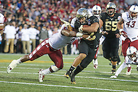 Annapolis, MD - December 27, 2016: Wake Forest Demon Deacons running back Matt Colburn (22) gets tackled by Temple Owls linebacker Avery Williams (2) during game between Temple and Wake Forest at  Navy-Marine Corps Memorial Stadium in Annapolis, MD.   (Photo by Elliott Brown/Media Images International)