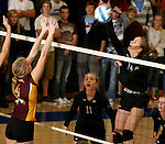 SIOUX FALLS, SD - SEPTEMBER 18: McKenna Mathiesen #4 from Harrisburg looks to block a kill attempt on Ellie Voss #14 from Sioux Falls Christian in the first game of their match Thursday night at Sioux Falls Christian. (Photo by Dave Eggen/Inertia)