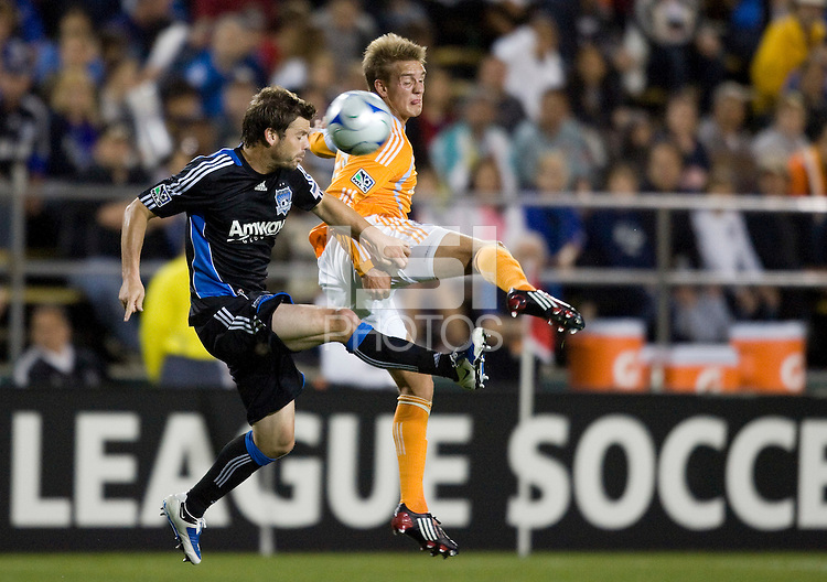 28 March 2009: Eric Denton of Earthquakes battles for the ball against Stuart Holden of Dynamo during the game at Buck Shaw Stadium in Santa Clara, California.  San Jose Earthquakes defeated Houston Dynamo, 3-2.
