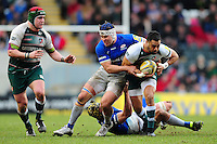 Telusa Veainu of Leicester Tigers is tackled by Schalk Brits of Saracens. Aviva Premiership match, between Leicester Tigers and Saracens on March 20, 2016 at Welford Road in Leicester, England. Photo by: Patrick Khachfe / JMP