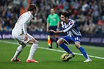 Real Madrid´s Gareth Bale (L) and Deportivo de la Courna´s Isaac Cuenca during La Liga match at Santiago Bernabeu stadium in Madrid, Spain. February 14, 2015. (ALTERPHOTOS/Victor Blanco)