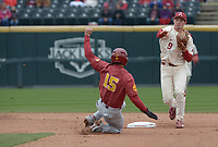 NWA Democrat-Gazette/J.T. WAMPLER Arkansas' Jax Biggers makes the throw to first for a double play after catching USC's Chase Bushor at second base Sunday March 4, 2018. Arkansas won 7-6 in seven innings.