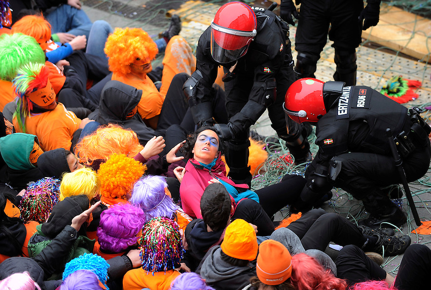 "Protesters wearing masks take part in a demonstration against the arrest of seven youths sentenced to six years in prison on charges of being members of the pro-independence Basque youth organization SEGI in Gasteiz on May 17, 2015. 4 of the 7 condemned youths were arrested by the police and the other 3 escaped. Igarki Robles, Aiala Zaldibar and Ibon Esteban have announced that they are taking part in this protest. Banner reads ""With disobedience, free"". PHOTO: ANDER GILLENEA"