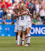 LYON,  - JULY 7: Crystal Dunn #19 celebrates with Morgan Brian #6 and Abby Dahlkemper #7 during a game between Netherlands and USWNT at Stade de Lyon on July 7, 2019 in Lyon, France.