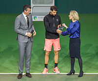 Rotterdam, The Netherlands, 18 Februari, 2018, ABNAMRO World Tennis Tournament, Ahoy, Singles final, Runner up Grigor Dimitrov (BUL) receives his trophy from Jolanda Jansen, left tournament director Richard Krajicek<br /> <br /> Photo: www.tennisimages.com