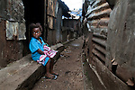 A girl sits along a walking path in Mabella quarter, Freetown, Sierra Leone, Aug. 15, 2012. Médecins Sans Frontières Belgium, in collaboration with the Sierra Leone Ministry of Health, is running four emergency cholera treatment centers to keep up with the number of patients. Many of the roughly 120 daily patients seen by the MSF team come from extremely impoverished areas of the densely-populated capital, where proper systems for drainage and waste disposal are almost non-existent. Outbreaks of water-borne diseases like cholera become even more likely during the rainy season, which is expected to last at least two more months.
