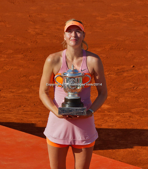 France, Paris, 04.06.2014. Tennis, French Open, Roland Garros, Maria Sharapova (RUS) with the trophy after defeating Halep in the final and wins Roland Garros<br /> Photo:Tennisimages/Henk Koster
