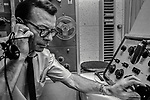 November 21, 1968, Modesto, California--Radio Man-- <br /> Wellesley Richard &quot;Dick&quot; Boynton was the news editor at KBEE AM, The Modesto Bee's sister radio station.  In November 1968, Dick volunteered to be my subject for a day-in-the-life-of-a-radio-reporter story.  My goal was to improve my story-telling skills.  I asked Dick to just do his job and ignore me.  We met at 6 a.m. at the Stanislaus County jail to get booking information then were off to Modesto Police Department to read the police logs.  At MPD, we discovered a big story was unfolding.  Stanislaus County Superintendent of Schools Fred Beyer and his deputy Joseph Howard had died the night before in a plane crash coming back from Fresno.  Making images was easy under these circumstances: I just followed Dick as he worked.  I moved in and out while Dick ignored me, just as I had asked.  When he finally sat down to write copy, he talked aloud and banged away on his typewriter.  Next thing I knew, he was on the air broadcasting the news.<br /> Boynton worked as the news editor for KBEE for nearly a decade under managers Roy Swanson and Ed Boyle.  Earlier in his career, his deep, resonant voice was heard on the airwaves at KWG in Stockton.  Boynton had also worked as a newsman for radio stations in Salinas and San Diego.  Among racing fans, Dick was known as a winning driver of dragsters and super-stock cars.<br /> In September 1986, Dick Boynton ended his own life. Some said he was despondent over being laid off from KBEE.  Photo by AL Golub/Golub Photography