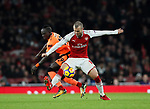 Arsenal's Jack Wilshere tussles with Liverpool's Sadio Mane during the premier league match at the Emirates Stadium, London. Picture date 22nd December 2017. Picture credit should read: David Klein/Sportimage