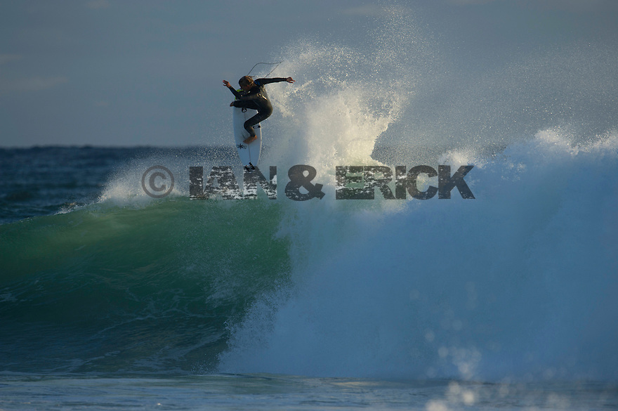 South African surfer at Gas Bay near Margaret River in Western Australia.