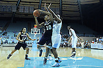 11 November 2012: Duquesne's Wumi Agunbiade (CAN) (10) and North Carolina's Tierra Ruffin-Pratt (right). The University of North Carolina Tar Heels played the Duquesne University Dukes at Carmichael Arena in Chapel Hill, North Carolina in an NCAA Division I Women's Basketball game, and a quarterfinal in the Preseason WNIT. UNC won the game 62-58