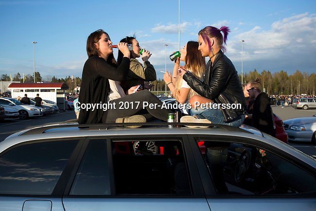 GISLAVED, SWEDEN - MAY 6: Swedish youth ride on top of a car during a meet, where new and old cars were displayed during a yearly event on May 6, 2017 in Gislaved, Sweden. Many came from neighboring towns and cities, and these car meets are popular all over Sweden, and part of a car culture in the country. (Photo by Per-Anders Pettersson/Getty Images)