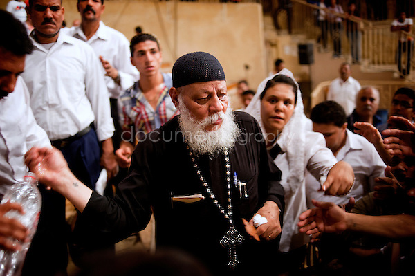 Father Samaan, at the end of the Thursday sermon in St. Simeon Church, performs exorcism session on the devoted Copts and Muslims who came from all over Egypt.<br />