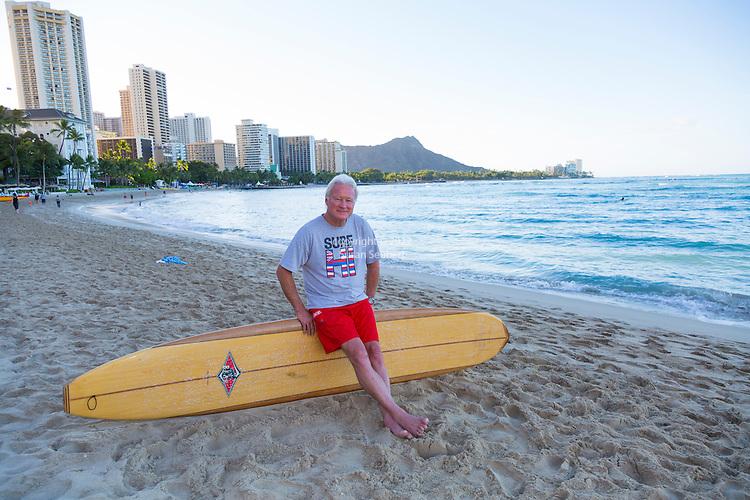 Randy Rarick, surf legend and director of the Hawaiian Triple Crown, at dawn on the beach at where he learned to surf. Waikiki, Honolulu, Oahu, Hawaii