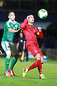 Portugal's Christiano Ronaldo taclkes Northern Ireland's Martin Paterson during a World Cup Qualifier in Belfast, Friday September 6th, 2013.  Photo/Paul McErlane