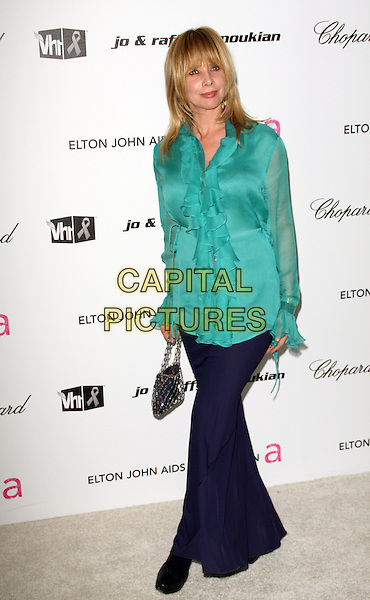 ROSANNA ARQUETTE.17th Annual Elton John AIDS Foundation Academy Award Viewing Party held at the Pacific Design Center, West Hollywood, California, USA..February 22nd, 2009.oscars full length blue skirt green blouse shirt silver bag purse .CAP/ADM/KB.©Kevan Brooks/AdMedia/Capital Pictures.
