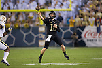 John Wolford (10) of the Wake Forest Demon Deacons makes a throw on the run during first half action against the Georgia Tech Yellow Jackets at Bobby Dodd Stadium on October 21, 2017 in Atlanta, Georgia.  The Yellow Jackets defeated the Demon Deacons 38-24. (Brian Westerholt/Sports On Film)