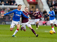 26th January 2020, Tynecastle Park, Edinburgh, Scotland; Scottish Premier League football, Hearts of Midlothian versus Rangers; Borna Barisic of Rangers and Lewis Moore of Hearts compete for possession